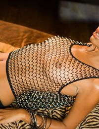 Lovely chocolate honey Bella Moretti spreads her legs and plumps her boobs as she models her see-through fishnet mesh shirt and skirt!