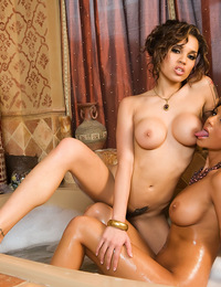 Amy Ried and Renae Cruz relax and soap up each other's naked body in a stylized Turkish bath!
