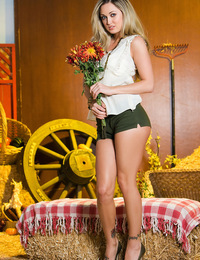 Melissa Jacobs sneaks you into her barn and strips off her cotton top and shorts before dragging you down with her naked self into the hay bales!