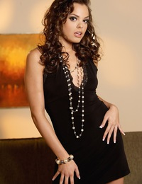 Renee Diaz is on fire as she unstraps her little black dress to romp around naked on a couch.